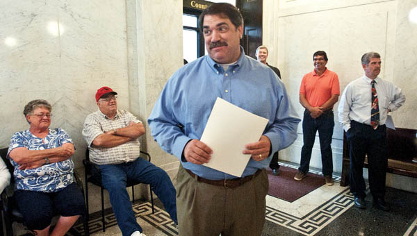 Lawrence County Engineers Doug Cade says his thank yous and good byes during a retirement party Wednesday at the Lawrence County Courthouse.