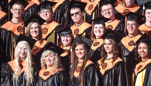 Students from the graduating class of 2015 pose for their class photo on the steps of Ironton High School on Sunday evening.