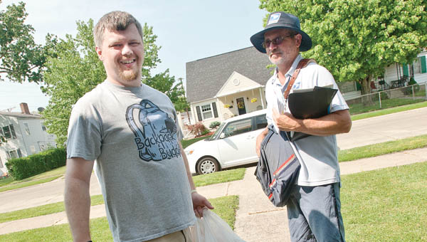 Ryan Munion, left, and Don Johnson, right, are on foot patrol as they deliver mail and pick up donated food items for the nationwide Stamp Out Hunger Food Drive Saturday in Ironton. The drive is in it's 23rd-year and donated items will be split between BackPack Buddies and the local city mission.