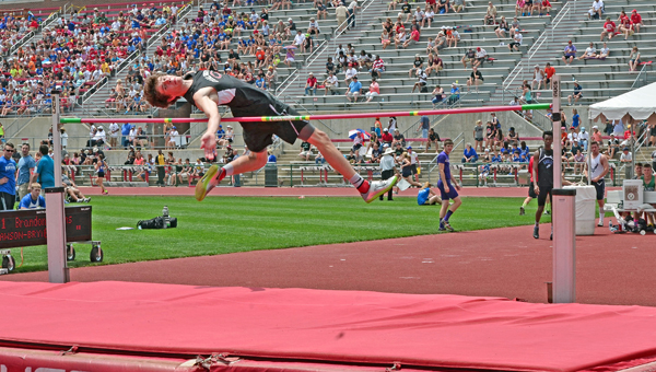Coal Grove Hornets' senior Brandon Adkins clears the cross bar on his way to winning a second straight Division III state championship in the high jump on Friday at Jesse Owens Memorial Stadium. (Jimmy Walker/The Ironton Tribune)