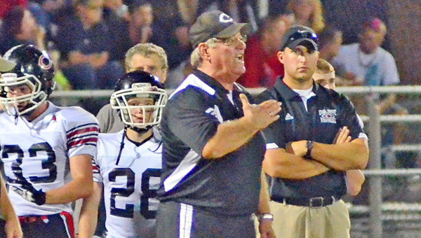 Former Coal Grove Hornets' head football coach Dave Lucas is shown signaling the defense to his team. (Kent Sanborn of Southern Ohio Sports Photos)