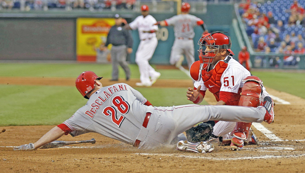Philadelphia Phillies catcher Carlos Ruiz tags out the Cincinnati Reds' Anthony DeSclafani at home plate in the fifth inning at Citizens Bank Park in Philadelphia on Thursday. The call was reversed due to catcher's obstruction. The Reds won 6-4. (MCT Direct Photo)