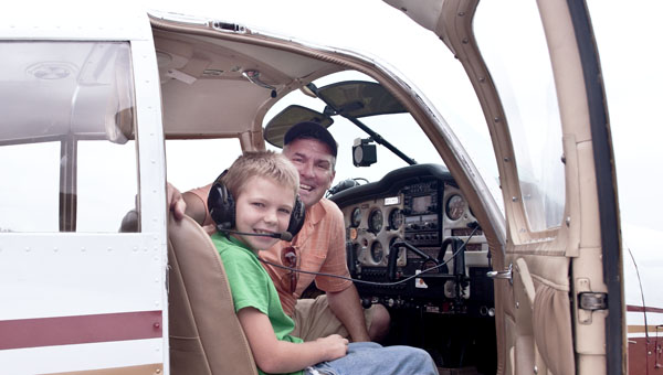 Eight-year-old Colton Noble gets ready for a ride in the sky with pilot Fred Hitchings during a community fly day on Saturday at the Lawrence County Airpark.