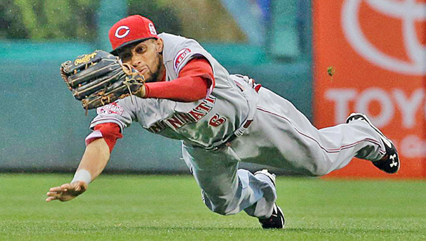 Cincinnati Reds' centerfielder Billy Hamilton makes a diving catch in the first inning of a line drive hit by Philadelphia's Ben Revere. The Phillies rallied to beat the Reds 5-4. (Courtesy of The Cincinnati Reds.com)
