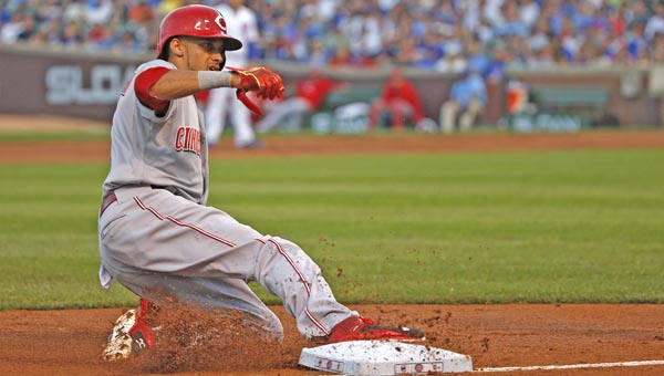 Cincinnati Reds' centerfielder Billy Hamilton steals third base during the third inning of Sunday night's game in Chicago. Hamilton stole five bases but the Reds lost 2-1 in 11 innings to the Cubs. (MCT Direct Photos)