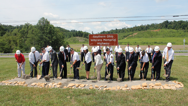 Ceremony speakers and veterans break ground Tuesday morning at Sunshine Church of Christ in Minford for the new Southern Ohio Veterans Memorial Highway.