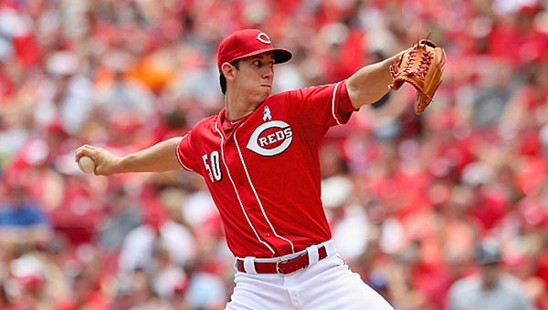 Cincinnati starting pitcher Michael Lorezen was sick but still threw seven innings of two-run baseball as the Reds beat the Miami Marlins 5-2 on Sunday. Lorenzen was pitching in a MLB game for the first time with his father watching. (Courtesy of The Cincinnati Reds.com)