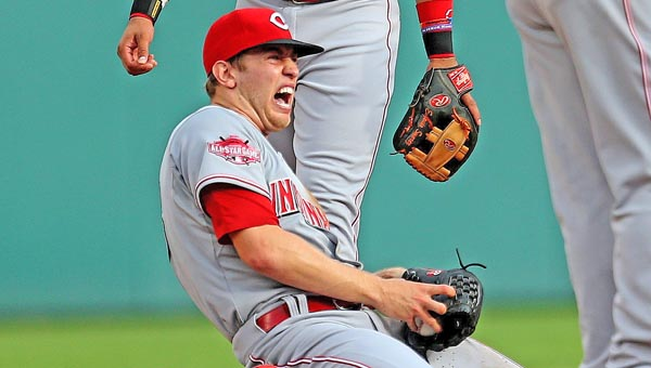 Cincinnati Reds' pitcher Jon Mascot winces in pain after he dislocated his non-throwing shoulder tagging out the Detroit Tigers' Anthony Gose during a rundown play in the first inning of Monday's game. The Reds lost 6-0. (MCT Direct Photo)