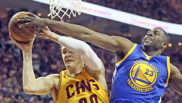The Cleveland Cavaliers' Timofey Mozgov (20) grabs a rebound in front of the Golden State Warriors' Draymond Green during the second quarter in Game 4 of the NBA Finals at Quicken Loans Arena in Cleveland on Thursday. (MCT Direct Photos)