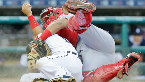 Cincinnati Reds' catcher Brayan Pena tags out Detroit Tigers' Anthony Gose as he tried to score from second base during the fifth inning of Tuesday's game. The Reds beat the Tigers 5-2 as Todd Frazier hit two home runs. (Courtesy of The Cincinnati Reds.com)