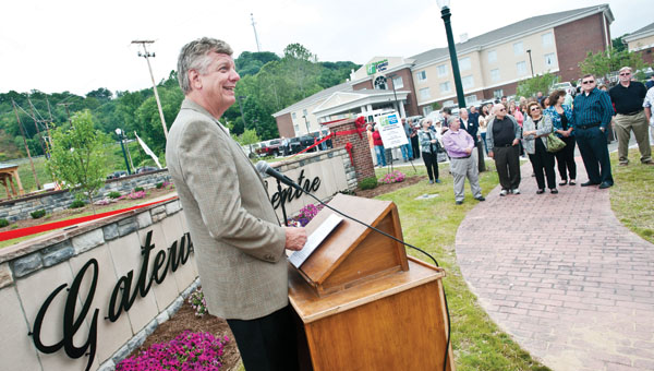 Mike Holtz, representative with Holiday Inn Express and Suites, speaks to the crowd during the Gateway Centre Dedication Tuesday in Ironton.