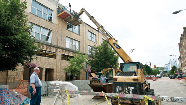 Traffic is blocked on Vernon Street, between South Second and Third, while workers from Southern Ohio Salvage work on the Ironton City Center on Thursday.