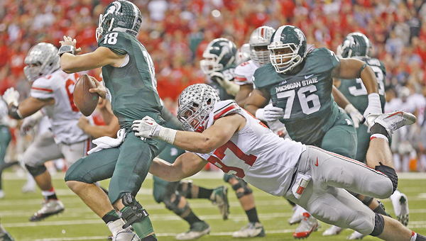 Ohio State Buckeyes' defensive lineman Joey Bosa sacks Michigan State quarterback Connor Cook. Bosa and teammates Corey Smith, Jalin Marshall and Dontre Wilson were suspended for the season opener at Virginia Tech for violations of athletic department policies. (MCT Direct Photos)
