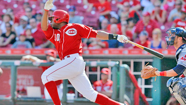 Cincinnati's Jason Bourgeois singles to drive in Eugenio Suarez in the ninth inning to tie the game at 3-3 and send it into extra innings. However, the Reds gave up two runs in the 11th inning as they lost 5-3 to the Cleveland Indians on Sunday. (Courtesy of the Cincinnati Reds.com)