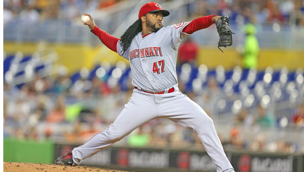 Cincinnati Reds pitcher Johnny Cueto throws against the Miami Marlins during the third inning on Sunday. Cueto lost his temper after being taken from the game in the sixth inning. (MCT Direct Photo)