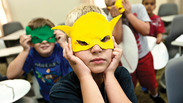 Elijah Posch shows off his superhero mask he made in class MARVELous Mayhem while attending the 2014 Academy of Excellence at Ohio University Southern.