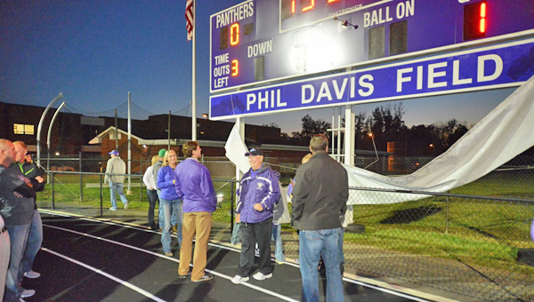 Former Chesapeake Panthers' Hall of Fame football coach Phil Davis died on Friday at the age of 69. Chesapeake held a dedication ceremony in 2013 by naming the field in his honor. Davis is standing under the sign in his honor. (Kent Sanborn of Southern Ohio Sports Photos.com)