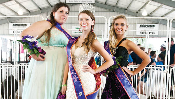 Kimberly Schmidt, center, is this year's Lawrence County Fair queen. Standing left to Schmidt is Katie Webb, first runner up, and to the right is Shelby Dalton, second runner up.