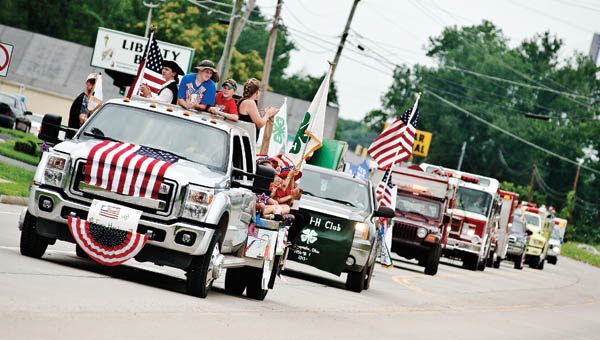 The Getaway Go-Getters 4-H Club cheer during the Lawrence County Fair Parade Sunday in Proctorville.