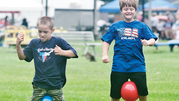 Eight-year-old Charlie Harper, left, and Evan Leffingwell, right, compete in the Kids Olympics.