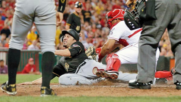 Cincinnati Reds' catcher Brayan Pena tags out Pittsburgh Pirates' Travis Ishikawa at home plate during the sixth inning of Friday's game. The Reds fell to the Pirates 5-4. (Courtesy of the Cincinnati Reds.com)