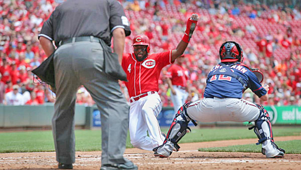 Cincinnati Reds' Brandon Phillips slides safely into home plate in the third inning on a sacrifice fly by Joey Votto. The Reds beat the Minnesota Twins, 2-1. (Courtesy of The Cincinnati Reds.com)