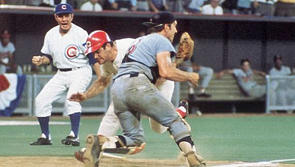 Cincinnati Reds' great Pete Rose runs over Cleveland Indians' catcher Ray Fosse to score the winning run in the 1970 All-Star Game to give the National League a 5-4 win in the 12th inning. The game was held at Riverfront Stadium in Cincinnati. (Courtesy of The Cincinnati Reds.com)