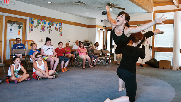 "Members of the Jeslyn Dance Gallery perform for eventgoers Wednesday at the Briggs Lawrence County Public Library South  Point Branch. As part of the summer reading program performances were given to the books ""Ten Rules to being a Superhero,"" ""Michael Recycle,"" and ""Do Superhero's Have Teddy Bears?"""