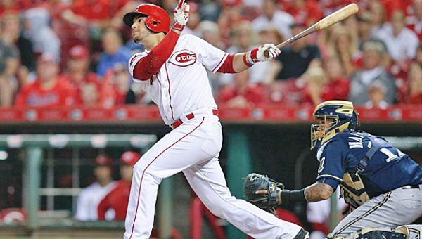 Eugenio Suarez singles home a run in the ninth inning for Cincinnati's only run in the Reds 12-1 loss to the Milwaukee Brewers on Friday. (Courtesy of The Cincinnati Reds.com)