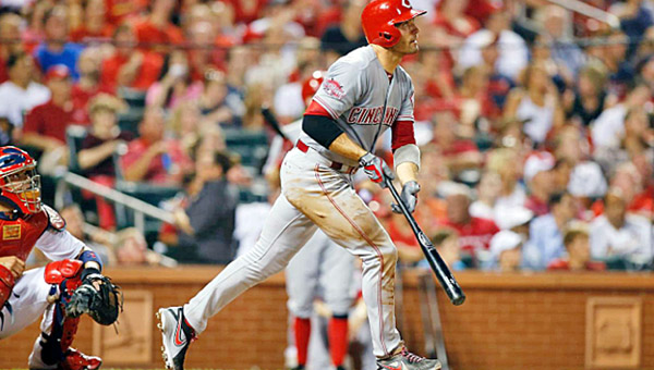 Cincinnati first baseman Joey Votto watches the flight of his ball as he hits a three-run homer in the sixth inning of Tuesday's game. Votto had three hits to back Mike Leake as the Reds blanked the St. Louis Cardinals 4-0. (Photo Courtesy of The Cincinnati Reds)