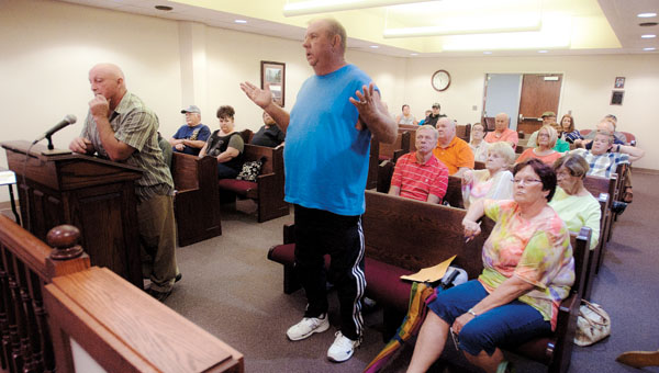 Cliff Back addresses Ironton City Council members during a public hearing Thursday about the rezoning of the former Whitwell Elementary School. Surrounding neighbors are not in favor of the rezoning.