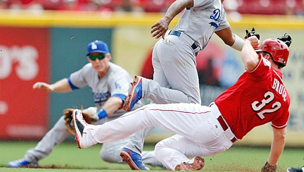 Cincinnati Reds' outfielder Jay Bruce (32) steals second base during the fifth inning of Thursday's game. Los Angeles Dodgers' Jimmy Rollins can't make the catch but is backed up by Chase Utley. The Dodgers edged the Reds 1-0. (Photo Courtesy of The Cincinnati Reds.com)