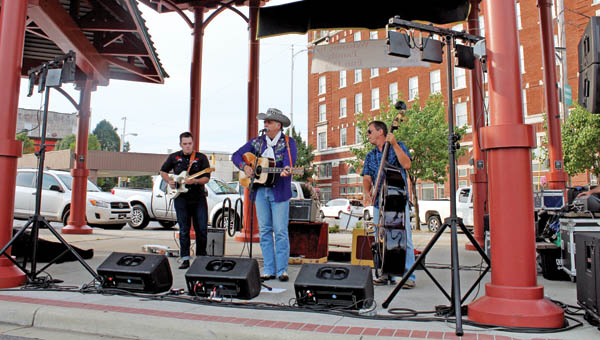 Rob McNurlin performs a variety of music Tuesday evening at the Farmer's Market as part of the Summer Concert Series hosted by Studimo and Ironton aLive.