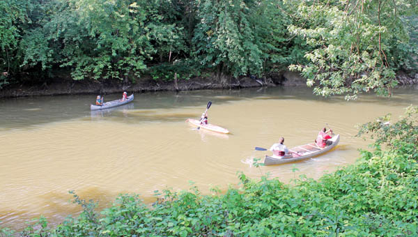 Participants take part in the annual canoe caper event Saturday hosted by the Symmes Creek Restoration Committee.