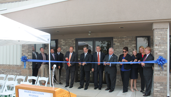 State, county and educational leaders cut the ribbon to mark the beginning of the Higher Education Regional Partnership and Training Center Monday morning at The Point.