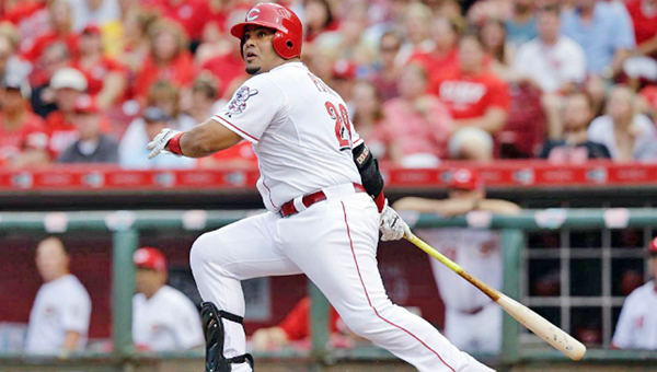 Cincinnati Reds' Brayan Pena doubles home two runs in the third inning of Wednesday's game against the St. Louis Cardinals. The Cardinals beat the Reds 4-3 in 13 innings. (Courtesy of The Cincinnati Reds.com)