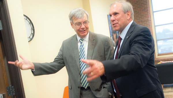 President Jack Finch with Tri-State Bible College, in South Point, gives Chancellor John Carey a tour of the new facility during an open house Thursday afternoon.