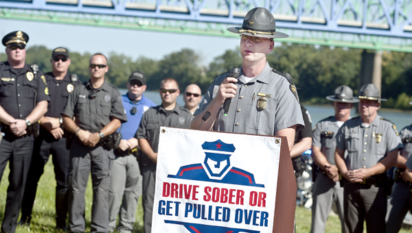 Ohio State Trooper David Allwine addresses the crowd during a special presentation on Friday at Ashland Riverfront Park.
