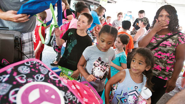 Area children from South Point look  through an array of backpacks during the Tools4School event Saturday in Ironton.