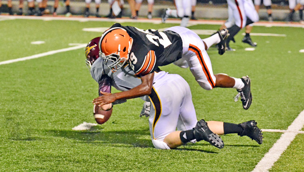 Ironton Fighting Tigers' Isaiah Brick-Scott (29) breaks up a pass attempt during last week's game against Russell. Ironton hosts Kentucky's No. 1-ranked Class A perennial power Beechwood this Friday. (Kent Sanborn of Southern Ohio Sports Photos)