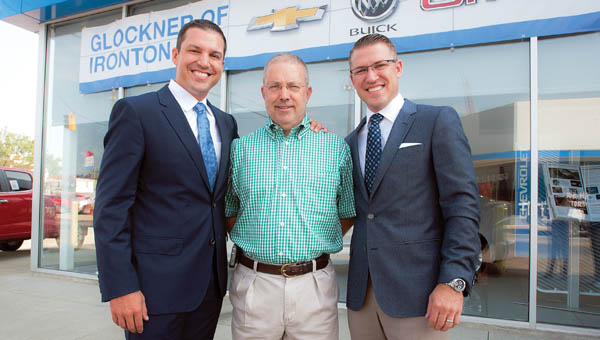 Tim and Mike Glockner pose with long-time businessman Bob Clyse.