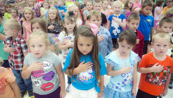 Students from Rock Hill Elementary School recite the Pledge of Allegiance.
