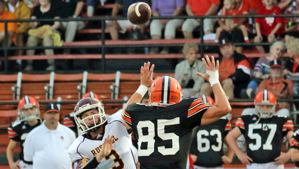 Ironton Fighting Tigers' defensive end Lucas Campbell (85) applies pressure on Russell quarterback Jacob McKee (3). The game was postponed due to the weather and will be played at 8 p.m. on Saturday.