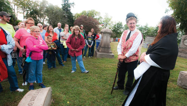 Patrick Terkhorn, left, and Dawnya Boggs, right, plays the characters Halsey Clark Burr and Harriett Kingsbury Burr during the annual Historical Walk Saturday at Woodland Cemetery.