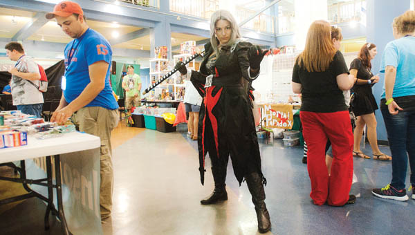 Mallory Grizzell is Lady Sephiroth from the Kingdom of Hearts making her way through the booths at the Highlanders Hero Con Saturday at the Highlands Museum and Discovery Center.