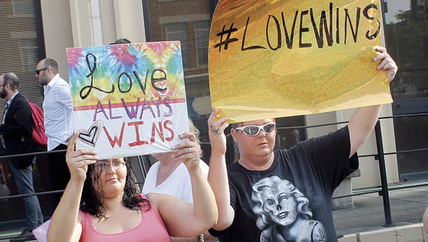 Protestors show their support of marriage equality in front of the Carl D. Perkins Federal Court Building Thursday morning.