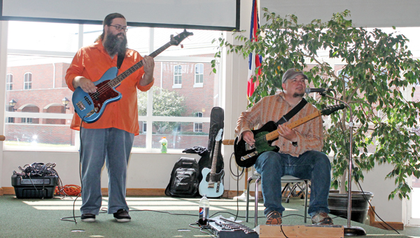 Mothman members Chuck Queen (left) and Todd Martin play a variety of music Wednesday afternoon in the Mains Rotunda at Ohio University Southern at the first concert of the OUS Brown Bag concert series.