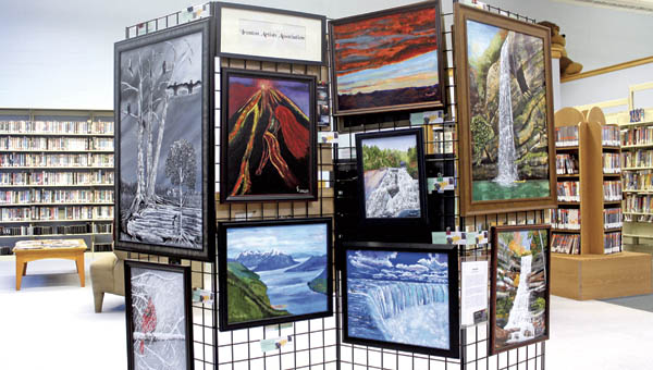 Oil paintings made with knives are on display at the Briggs Lawrence County Library by artist Kathleen Hollett, of the Ironton Artists Association.