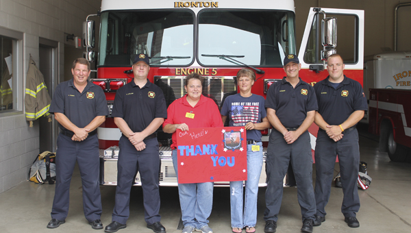 Amy Moore and Trina Hunt (center) with Cash Express in Russell, delivered thank you posters and cake to the Ironton Fire Department on 9/11. Pictured from the department are Captain Craig Thomas, Aaron Collins, Mike Misner and Zack Kriebel.