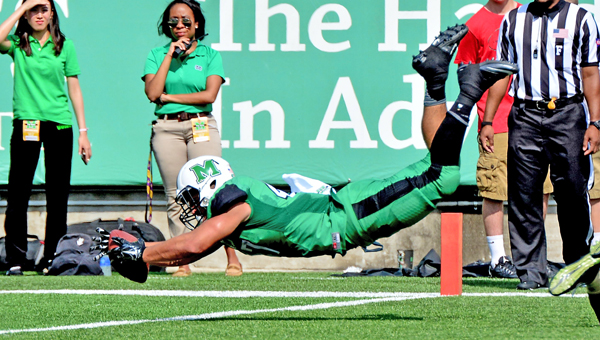 Marshall Thundering Herd running back Devon Johnson dives into the end zone for a touchdown during a 41-31 win over Purdue on Sunday in the season opener. It was Marshall's first-ever win over a Big Ten team. (Kent Sanborn of Southern Ohio Sports Photos)